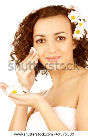 beautiful woman  with camomile flower on white background
