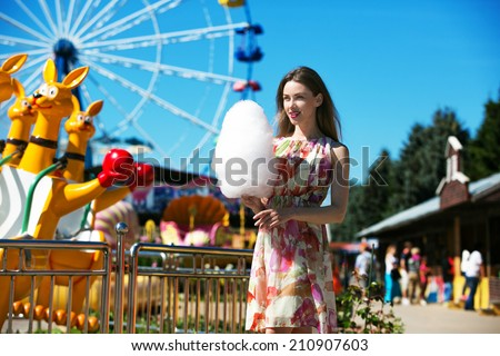 beautiful woman with candy floss in the park