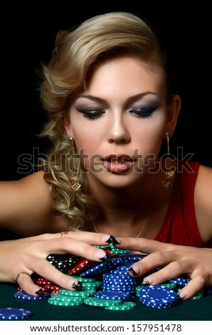 Beautiful woman with casino chips a black - stock photo