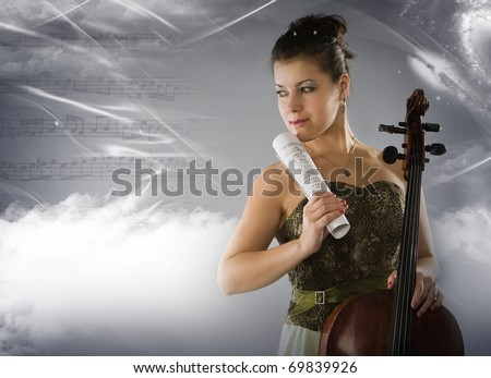 Beautiful woman with cello on a space background - stock photo