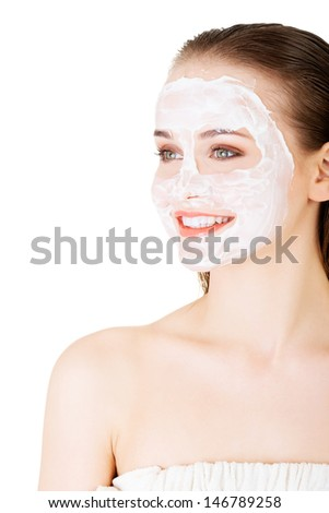 Beautiful woman with clay facial mask, isolated on white