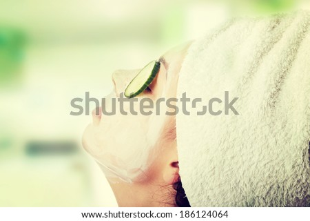 Beautiful woman with clay mask  - stock photo