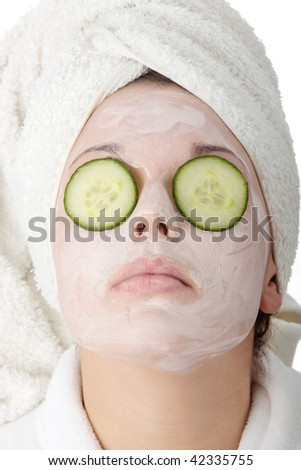 Beautiful woman with clay mask isolated - stock photo