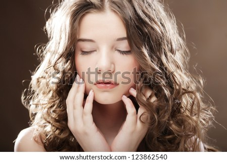 Beautiful woman with closed eyes - stock photo