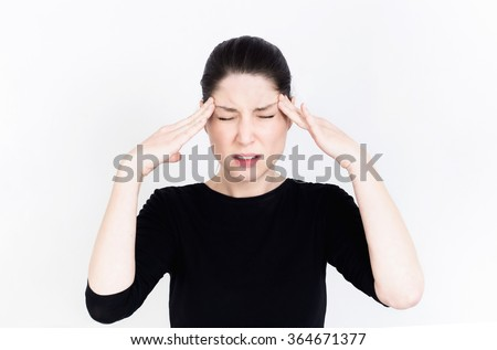 Beautiful woman with closed eyes and her hands on her head. Black and white Studio photography