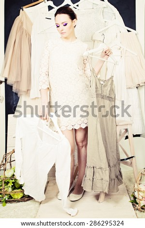 Beautiful Woman with clothes - stock photo