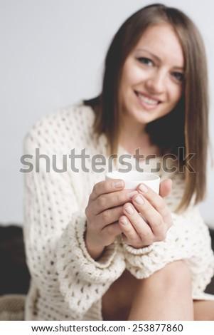 Beautiful woman with coffee. studio shot. - stock photo