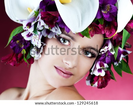 beautiful woman with colorful flowers of alstroemeria