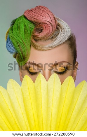 Beautiful woman with colorful hair color background - stock photo