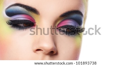 Beautiful woman with colorful make-up over white background