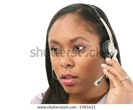 Beautiful woman with concerned expression wearing headset. - stock photo