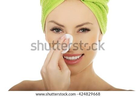 Beautiful woman with cotton pad. - stock photo
