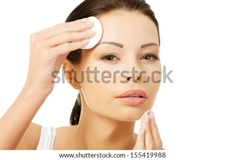 Beautiful woman with cotton pad , isolated on white  - stock photo