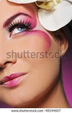 Beautiful woman with creative make-up - stock photo