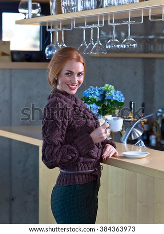 beautiful woman with Cup of coffee in the bar
