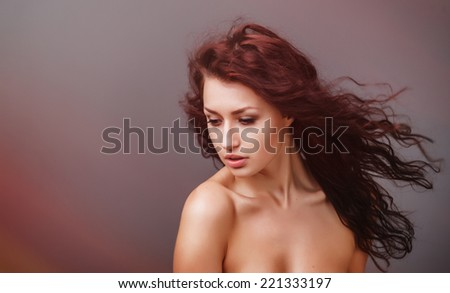 Beautiful woman with curly hair and evening make-up. Beauty. Fashion art photo