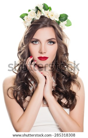 Beautiful Woman with Curly Hair Isolated on white background. Portrait of Sexy Fashion Model with Bright Makeup and Rose Flowers - stock photo