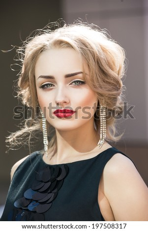 Beautiful woman with elegant hairstyle. Fashion photo