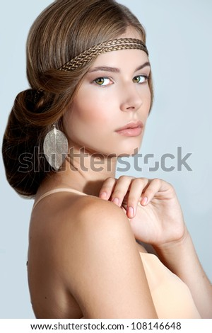 Beautiful woman with evening make-up and evening hairstyle. Jewelry and Beauty. Fashion phot - stock photo