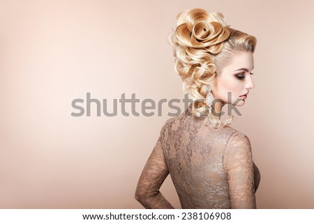 Beautiful woman with evening make-up and salon hairdo . Smoky eyes. Complicated hairstyle for party - stock photo