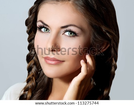 Beautiful woman with evening make-up and stylish hairstyle.Bride - stock photo