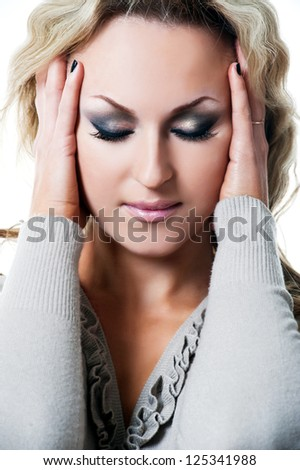Beautiful woman with evening make-up. headache - stock photo
