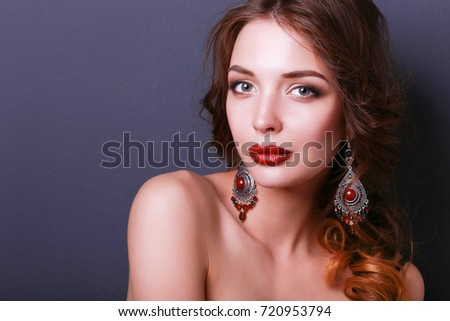 Beautiful woman with evening make-up in black dress