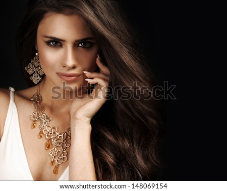 Beautiful woman with evening make-up. Jewelry and Beauty. Fashion photo - stock photo