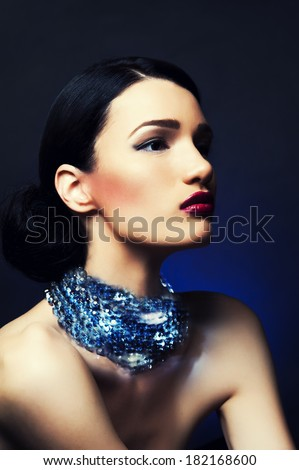 Beautiful woman with evening make-up. Jewelry and Beauty. Fashion photo. Diamonds.