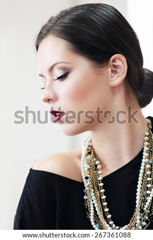 Beautiful woman with evening make-up. Jewelry and Beauty. Fashion photo, focus on lips - stock photo