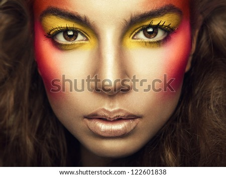 beautiful woman with eye shadows on face - stock photo