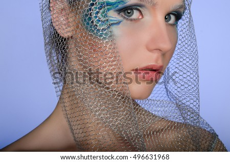 beautiful woman with face art mermaid with blue background