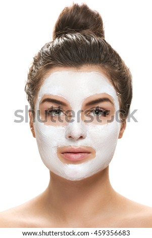 Beautiful woman with facial mask on white background