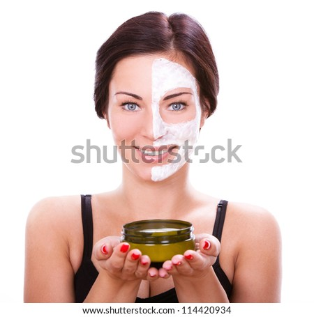 Beautiful woman  with facial mask over white background - stock photo