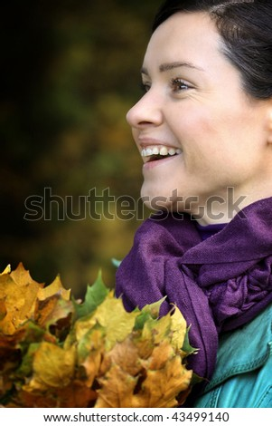 beautiful woman with fallen leaves