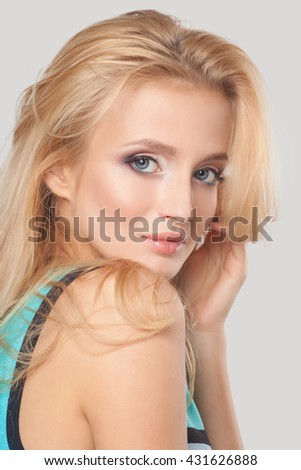 Beautiful woman with fashion make-up and blonde hair, portrait of an young girl isolated on white