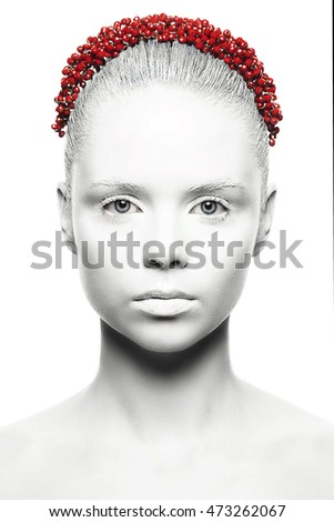 Beautiful woman with fashion make-up. White skin  and lips on a white background red