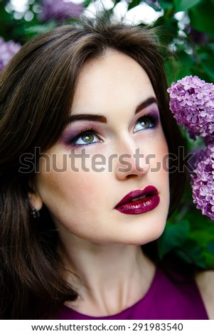 Beautiful woman with fashion makeup
