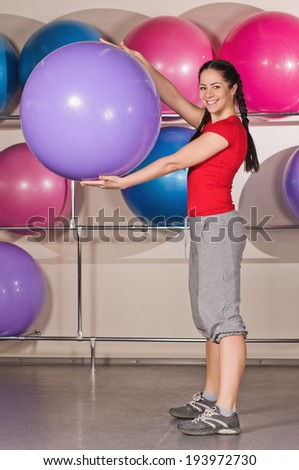 beautiful woman with fitness ball at gym - stock photo