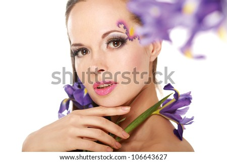 Beautiful woman with flower iris