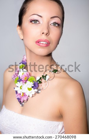 Beautiful woman with flower necklace. - stock photo