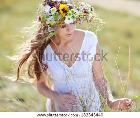 Beautiful woman with flower wreath - stock photo