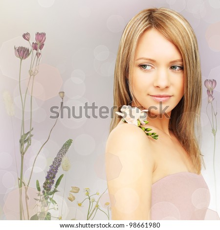 Beautiful woman with flowers - fantasy background - stock photo