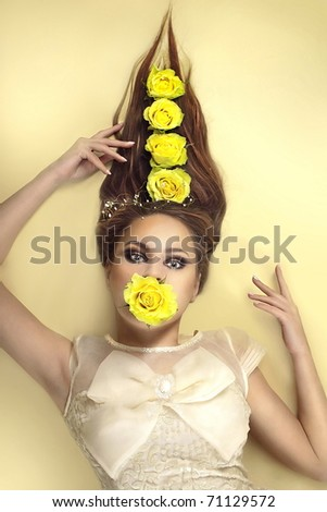 beautiful woman with flowers on a yellow background