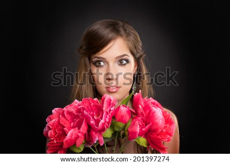 Beautiful woman with flowers on black background