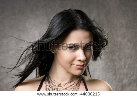Beautiful woman with fluttering long, dark hair. - stock photo