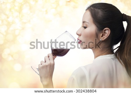 beautiful woman with glass red wine on bokeh background - stock photo