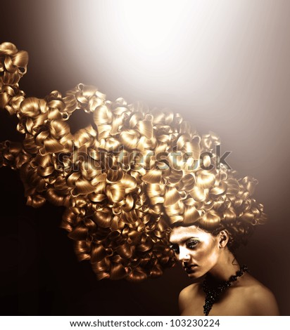 Beautiful woman with gold hair and light