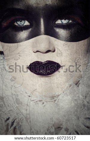 beautiful woman with gothic make-up covered in painted mask on grunge texture designed by me - stock photo