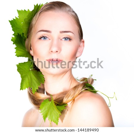 Beautiful woman with grapes foliage in hair